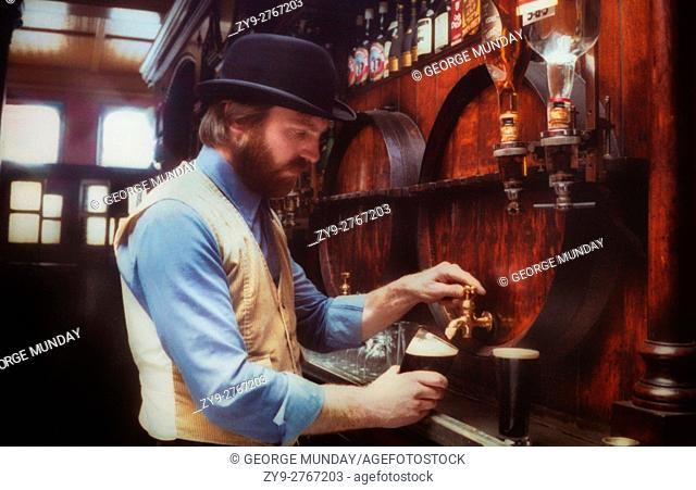 Barman Pouring Stout in Ryan's Traditional Pub with Victorian features. Parkate Street, Dublin City, Ireland