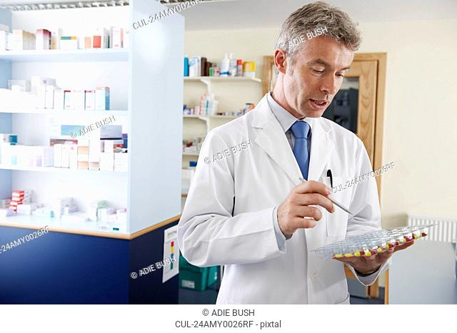 Pharmacist counting pills