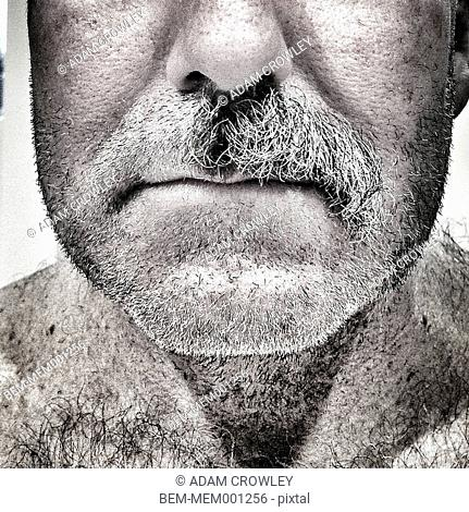 Close up of Caucasian man with half a mustache