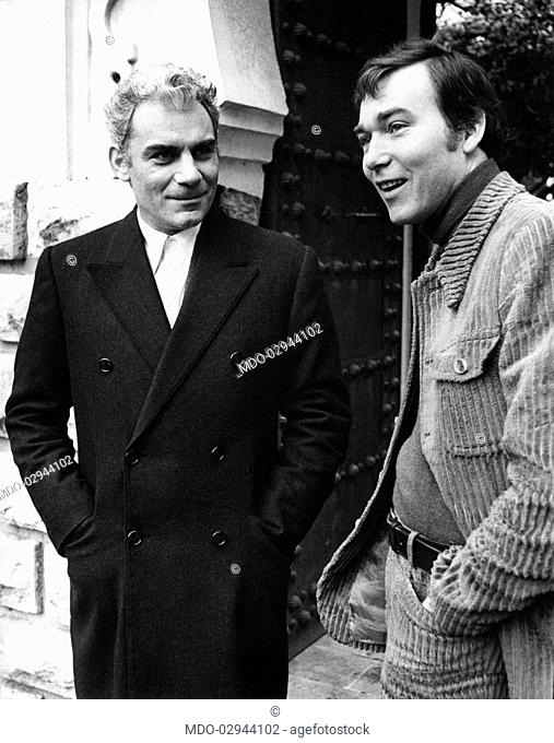 Italian actor and scenarist Gian Maria Volonté smiling with French director Yves Boisset on the set of the film Plot. Paris, 1972