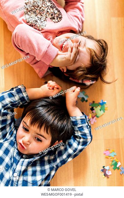 Boy and girl lying on the floor
