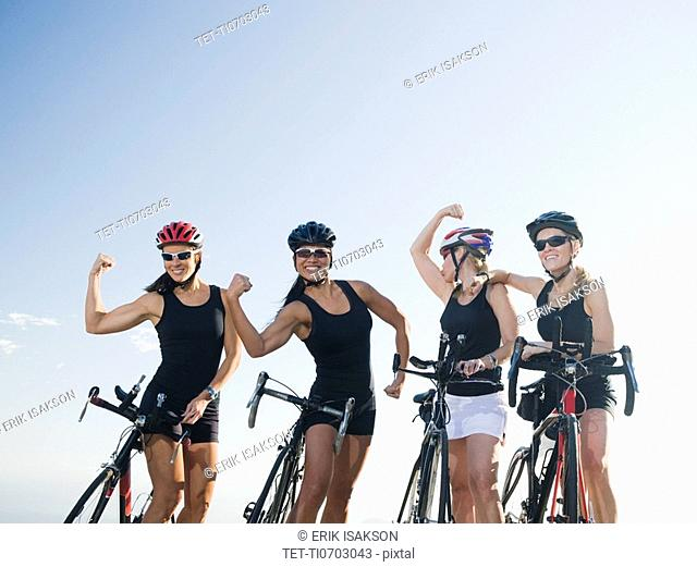 Cyclists flexing their biceps