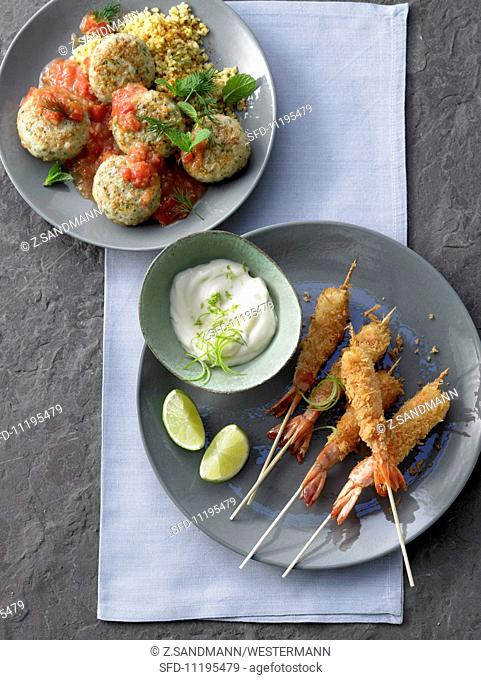 Breaded shrimp kebabs with dip and shrimp balls with tomato sauce