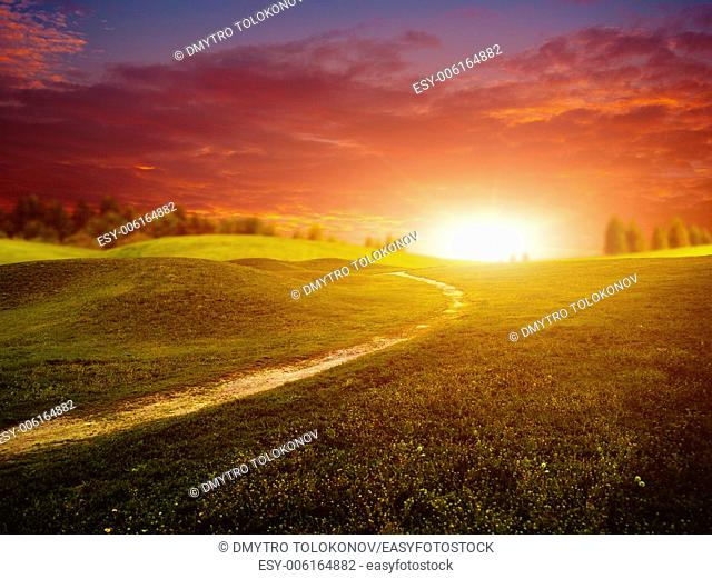 Fantastic sunset over summer green hills, abstract environmental backgrounds