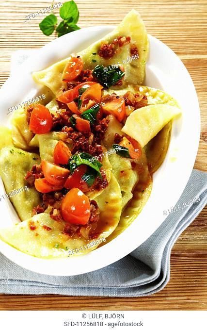 Swabian ravioli with wild garlic and tomatoes