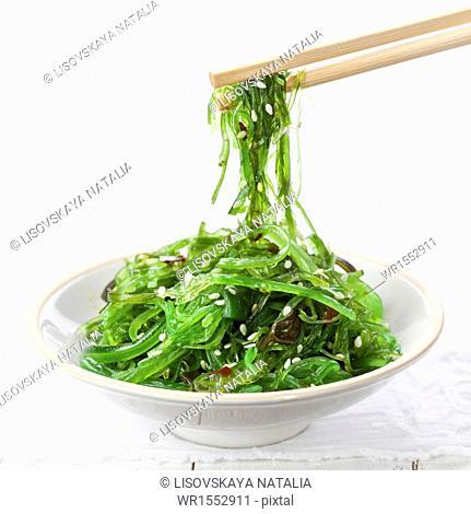 Bowl of Seaweed Salad sprinkled with Sesame Seeds
