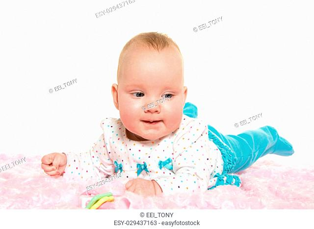 Cute baby six-month-old girl with polka dotted shirt and light blue pants on white background