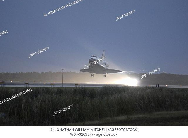 USA Florida -- 2006 -- Discovery touches down on Runway 15 at NASA's Kennedy Space Center Shuttle Landing Facility as the sun sets