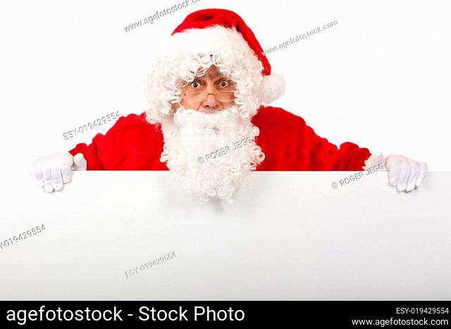 Surprised Santa Claus is holding a Christmas advertisment board