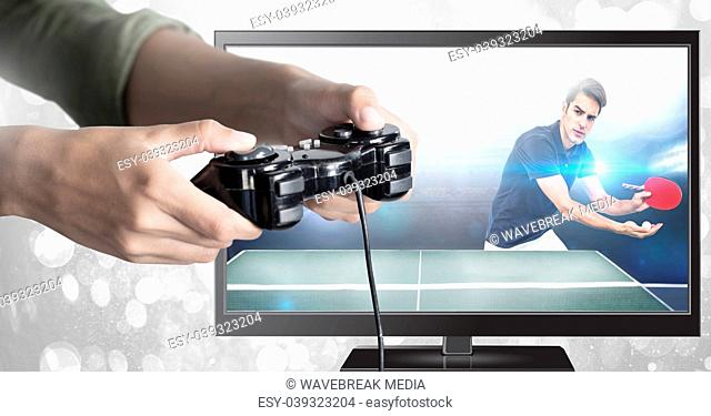 Hands holding gaming controller with table tennis on television