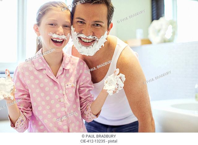 Father and daughter playing with shaving cream