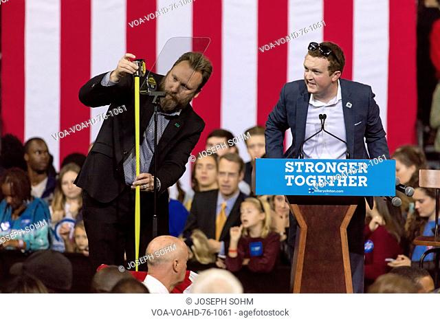 WINSTON-SALEM, NC - OCTOBER 27 , 2016: Campaign workers prepare podium for Hillary Clionton and US First Lady Michelle Obama presidential campaign event in...