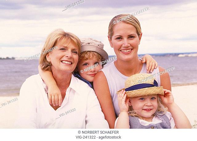beach-scene, portrait, group picture, 3 generations, blond woman, 50 years, wearing white blouse, with her daughter, 25 years, and her 2 children, blond girl