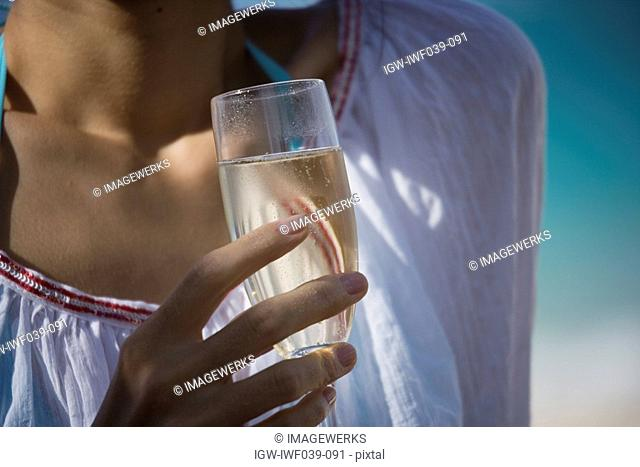 Close-up of a woman holding wineglass
