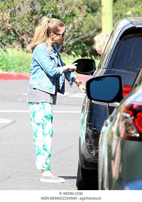Rebecca Gayheart stops by Coldwater Park and takes a walk holding her mobile phone, while her daughter stays in the car in Beverly Hills