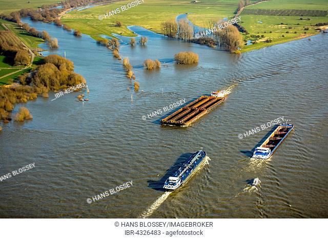 Aerial view, cargo ships on the Rhine during flooding, towboat, red dangerous goods ship, bulk cargo carrier, Kalkar, Lower Rhine, North Rhine-Westphalia