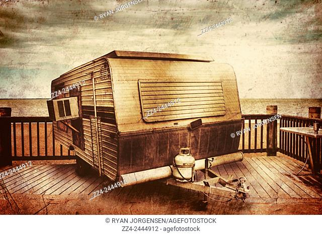 Old relic caravan from 1970s stationed at an Australian camp site overlooking the pacific ocean. Antique holidays