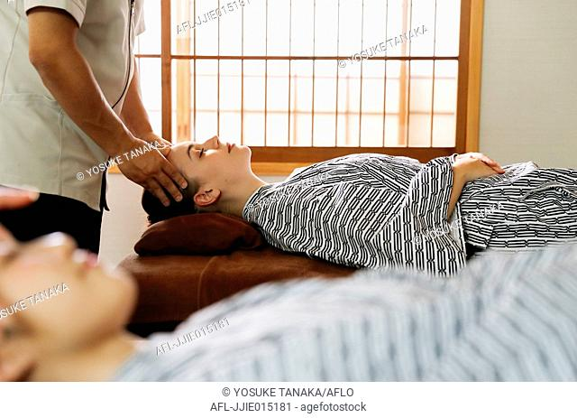 Caucasian woman getting a massage at a spa in Tokyo, Japan
