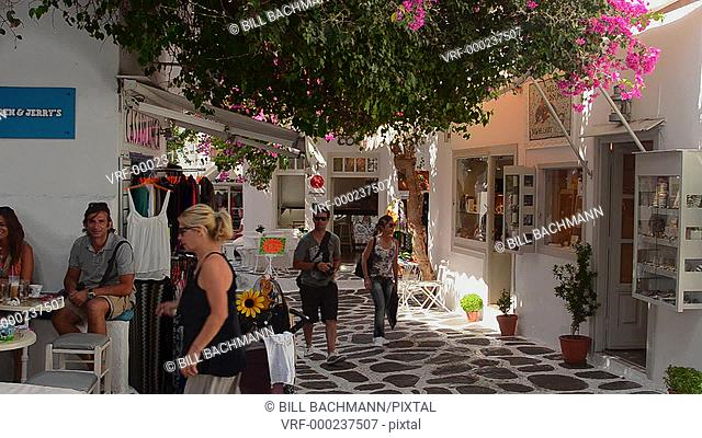 Mykonos Greece center of island with shops and shoppers walking thru city and white buildings downtown