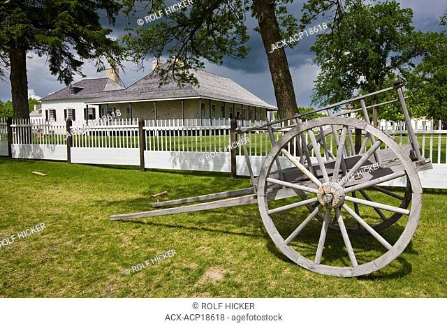 Big House and old wagon, Lower Fort Garry, a National Historic Site, Selkirk, Manitoba, Canada