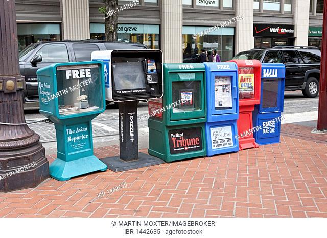 Newspaper boxes on the side of the road, Portland, Oregon, USA