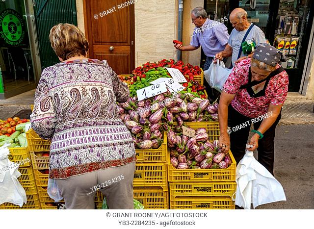 Local People Buying Vegetables At The Thursday Market In Inca, Mallorca - Spain