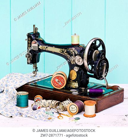 Vintage sewing machine and reels of cotton thread