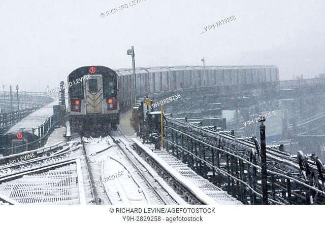 A Flushing Line train departs the Queensboro Plaza station in New York during the city's first major winter storm of the season