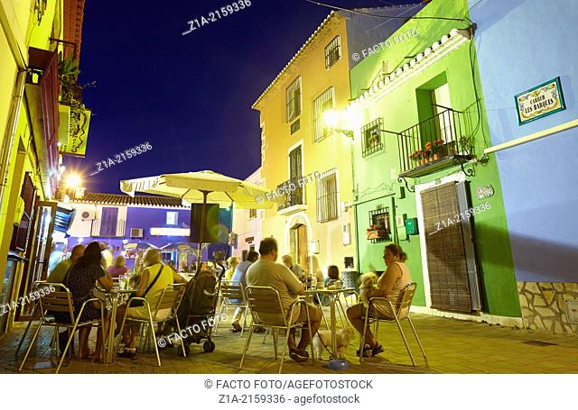 Restaurant terraces at the Port district by night. Denia. Alicante. Spain