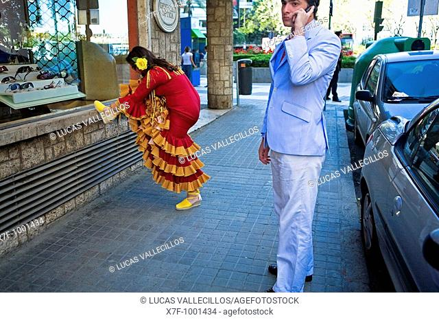 Woman wearing traditional gypsy dress in Asunción street during the April Fair Feria de Abril  Seville, Andalusia, Spain