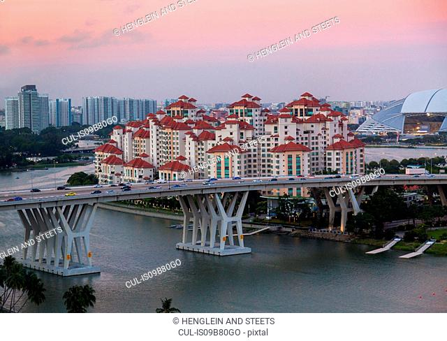 Elevated cityscape with highway bridge and apartment developments at dusk, Singapore, South East Asia
