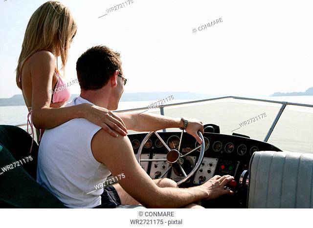 young couple, con, driving, yacht, trip, portrait