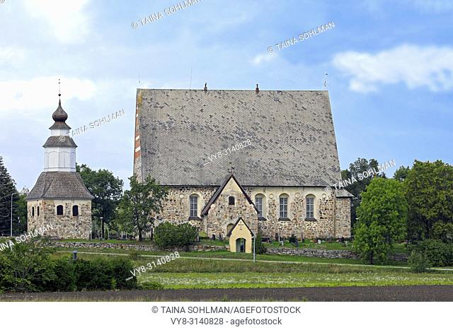 The medieval graystone Sauvo Church, South of Finland, in early autumn. The church was built between 1460-1472