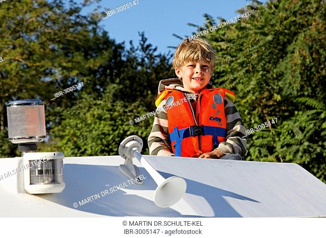 Boy on a houseboat on the Canal du Midi