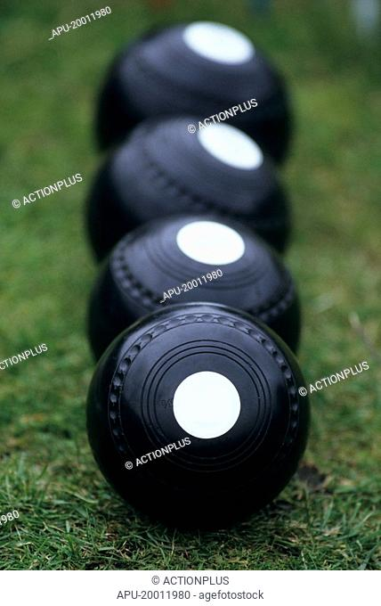 Sets of bowls on lawn bowls court
