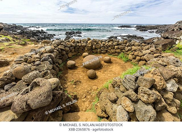 "Lava rock formation known as """"The Navel of the World"""" at Ahu Te Pito Kura on Easter Island, Isla de Pascua, Rapa Nui, Chile"