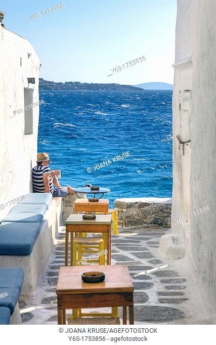 Siesta in a bar in Mykonos, Greece