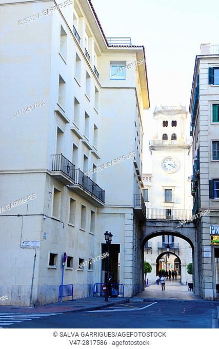 Old door of the city (Porta del Mar) and the city hall of Alicante, Valencia, Spain
