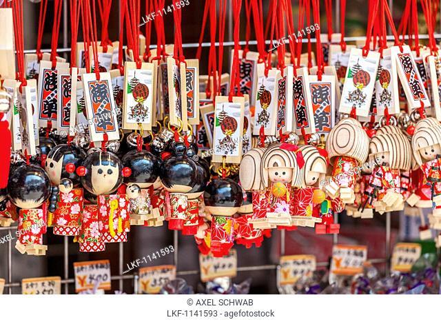 Small wooden dolls at a souvenir shop at Nakamise Street in front of Senso-ji in Asakusa, Taito-ku, Tokyo, Japan