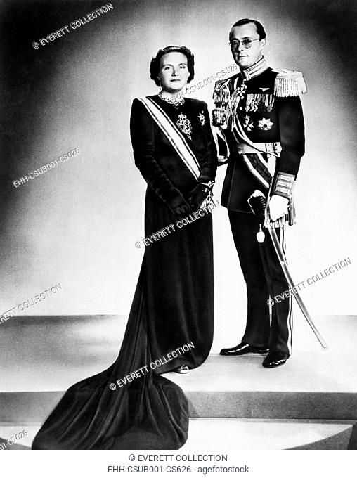 Queen Juliana of the Netherlands and her consort, Prince Bernhard, on her accession to the throne. She succeeded the 68-year-old Queen Mother, Wilhelmina