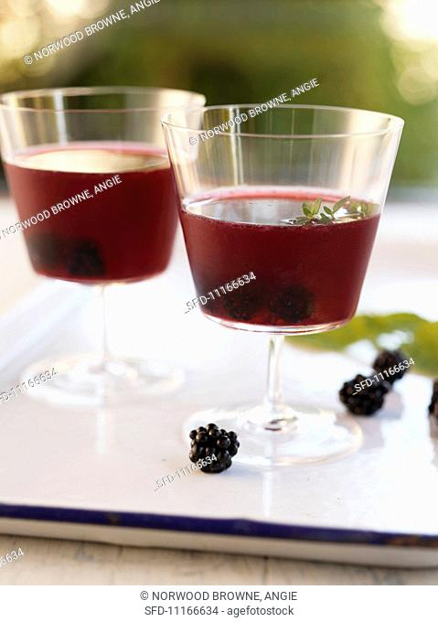 Two Blackberry Cocktails on a White Tray