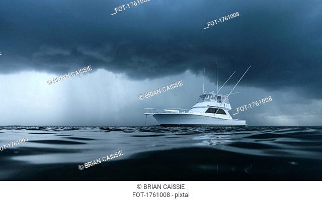Yacht on ominous stormy ocean