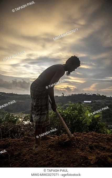 A man Rohingya Muslims refugees cutting hill for his new shelter for living at balu khali camp teknaf