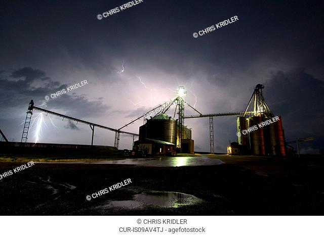 Lightning sparks over silos at Grainton, Nebraska, 24 May 2013