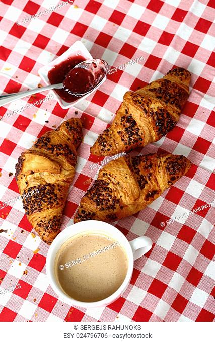 Food. Delicious croissant on the table