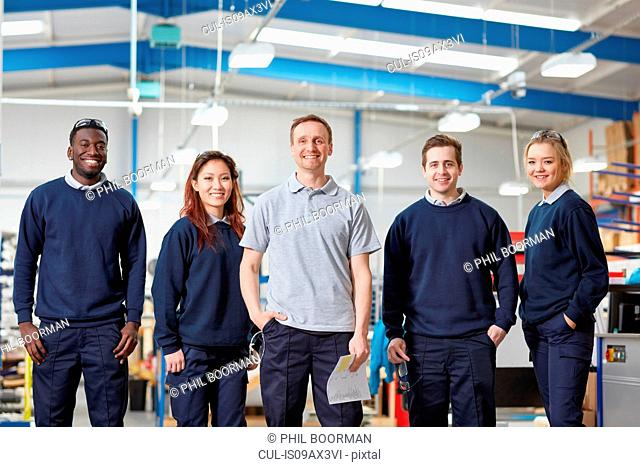 Portrait manager and team in manufacturing factory