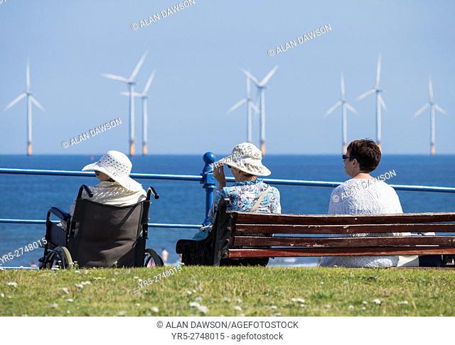 Elderly women enjoying the sunshine at Seaton Carew on the north east coast of England, United Kingdom