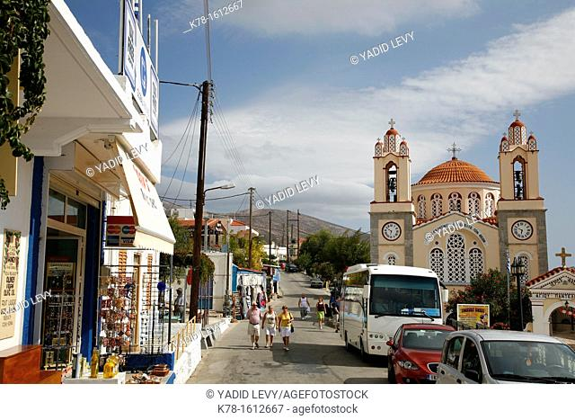 Main street in the village of Siana with Agios Pandelimonos Byzantine Church, Rhodes, Greece