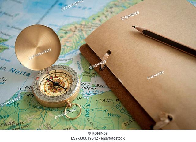 gold plated old compass lying on the map of Europe
