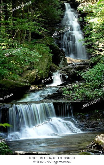 Multiple waterfalls snake through the landscape at Rickett's Glen State Park, Pennsylvania, USA
